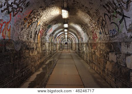 Dirty pedestrian tunnel at night