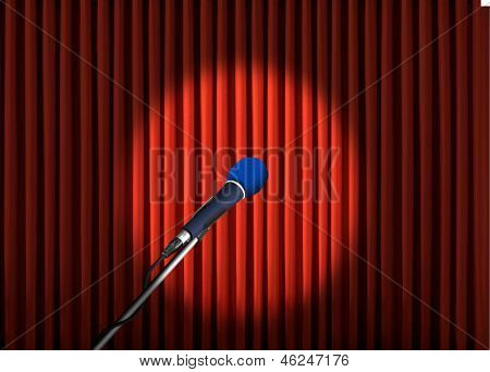 Microphone under spotlight over red curtains
