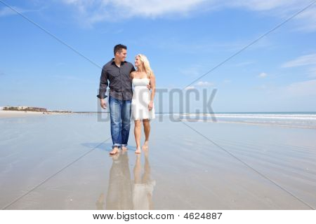 Happy Couple On A Beach.