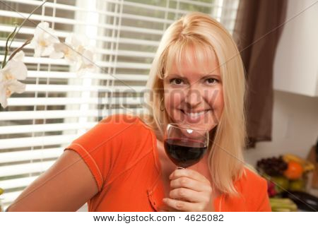 Cute Blond Woman With A Glass Of Wine