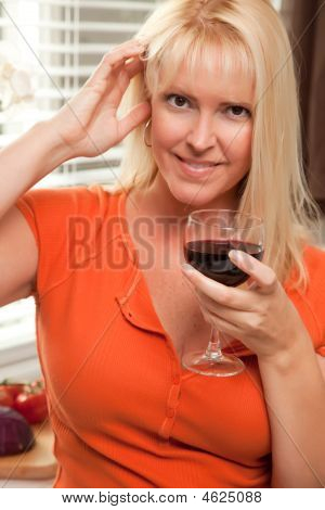 Flirtatious Blond With A Glass Of Wine