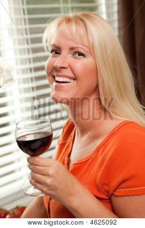 Laughing Blond Girl With A Glass Of Wine