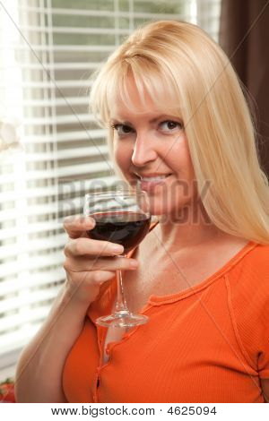 Sexy Blond With A Glass Of Wine
