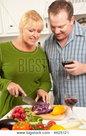 Smiling Couple Enjoy Preparing A Meal