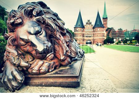 Lion near Holstein Gate (built in 1478), Lubeck, Germany. Cross-processed colors