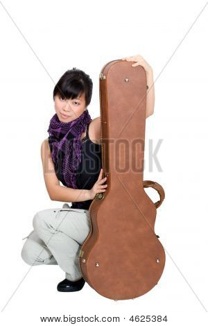 Asian Woman With Guitar Case