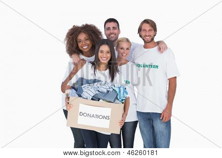 Smiling group of volunteers holding donation boxvolunteers  on white background