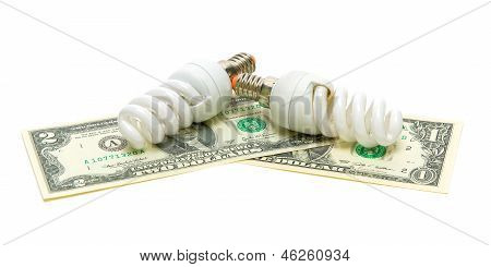 Two Light Bulbs And U.s. Dollars Isolated On White Background