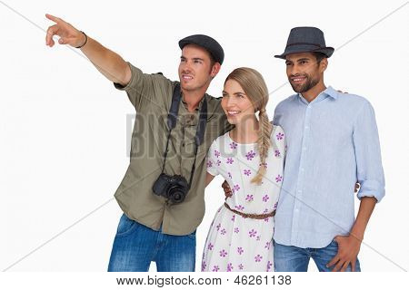 Photographer pointing to something with friends on white background