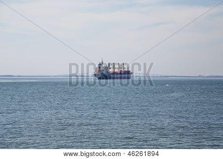 Dredging Ship Witih Bridge In Background