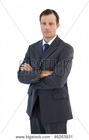 Charismatic businessman standing with arms crossed on white background