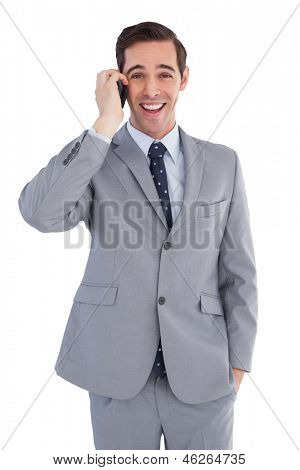 Happy businessman on the phone close up on white background