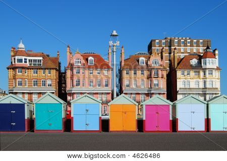 Colored Beach Huts At Brighton. East Sussex. England