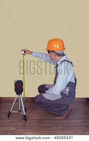Foreman Checks The Quality Of A Laser Level