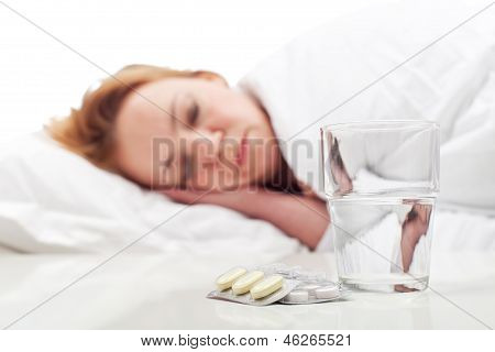 Woman Fighting Sickness With Pills And Resting