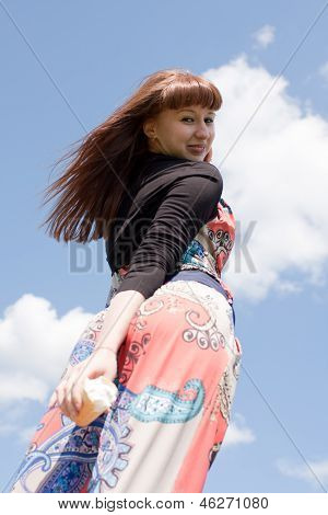 woman on the sky background