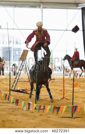 MOSCOW - SEP 6: A man rides horse standing in show of Center for Trick Riding Equestrian Federation of Moscow region on Horse show and exhibition Equiros in Sokolniki, Sept 6, 2012 in Moscow, Russia.