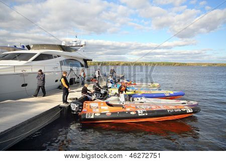 MOSCOW - SEP 29: Sportsmen prepare for competition at Powerboat Race Show 2012 in yacht club Gals, Sep 29, 2012 Moscow, Russia. Event is organized by Russian Racing Group .