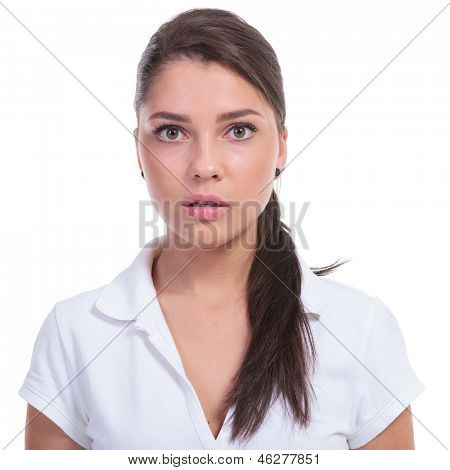 casual young woman looking baffled at the camera. isolated on white background