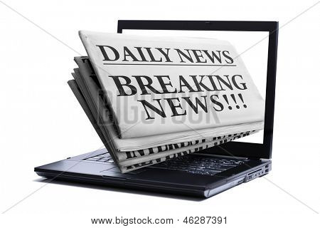 Newspaper through a laptop screen  concept for latest online news