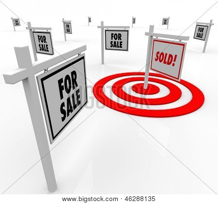 Many home for sale real estate signs and one reading Sold in a bulls-eye target to illustrate targeted marketing and selling a house