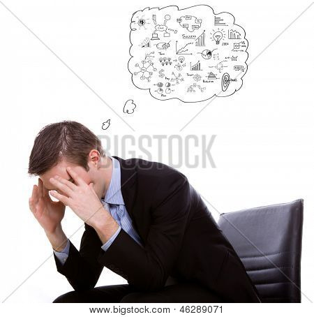 Portrait of a young business man depressed from work