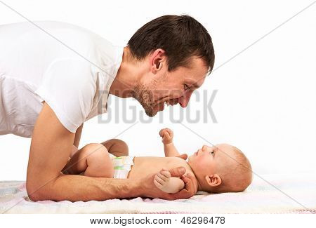 Caucasian father playing with baby son