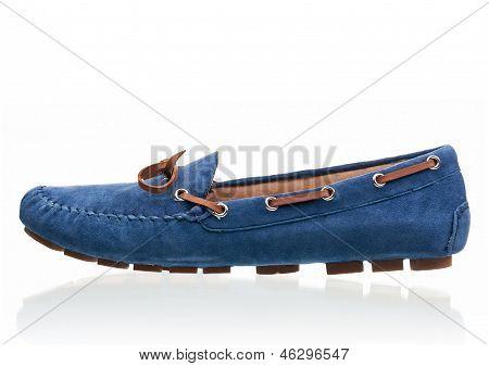 Blue female loafer over white