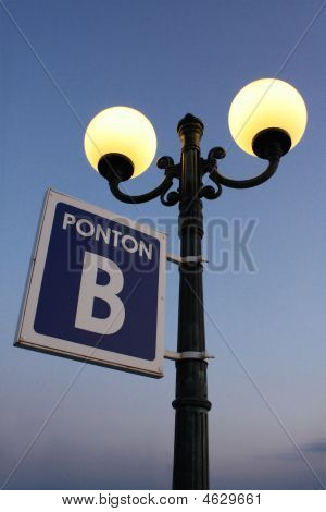 Street Lamp With Plate On Pier