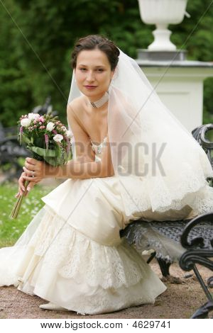 Pretty Smiling Bride With Bouquet
