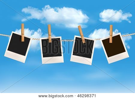 Background with photos hanging on a rope in front of a blue sky with clouds. Vector