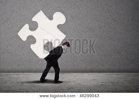 Businessman Build Puzzle