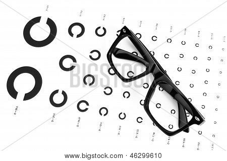 Table For An Eye Examination By An Ophthalmologist With Symbols. Dark Glasses.