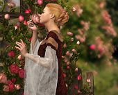 stock photo of fragrance  - a lady in medieval garb smelling a rose - JPG