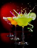 foto of cosmopolitan  - Fruit cocktails on black background - JPG