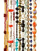 foto of chokers  - Beaded necklaces fashion composition on white background - JPG