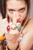 stock photo of offensive  - Young girl showing middle finger - JPG