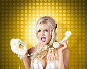 stock photo of hysterics  - Image of a hysterical pinup girl tangled in a fifties phone cord knot - JPG