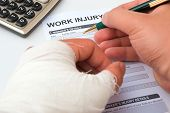 image of hurted  - filling up a work injury claim form - JPG