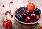 stock photo of strawberry  - tasty summer fruits on a wooden table - JPG