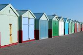 picture of beach hut  - Row of brightly colored  - JPG