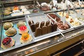 image of bakeshop  - Showcase of cakes macarons ice cream pastry in window display canteen for tasty desert food - JPG