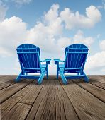 foto of retired  - Retirement relaxation and financial planning symbol with two empty blue adirondack chairs on a wood patio deck with a sky view as a business freedom concept of future successful investment strategy - JPG
