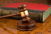 stock photo of law-books  - a Wooden gavel and book as symbol for jurisdiction - JPG