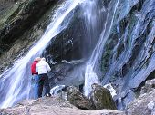 Tourists At Waterfall poster