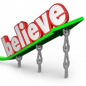 The word Believe lifted on an arrow by a team of people to illustrate the importance of faith in you