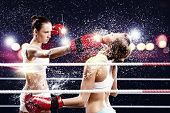 foto of boxing ring  - Two young pretty women boxing in ring - JPG