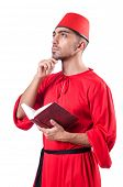 stock photo of tunic  - Young turk with book on white - JPG