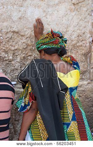 JERUSALEM, ISRAEL-MARCH 14, 2006:A woman prays at the Wailing Wall.
