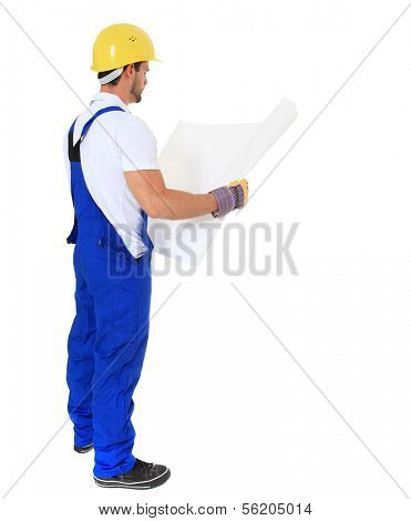 Full length shot of a construction worker studying construction plan. All on white background.